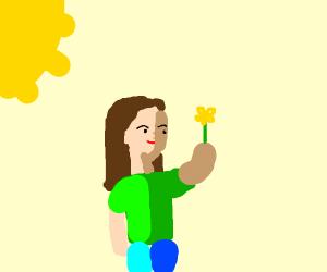 Girl admires sunflower