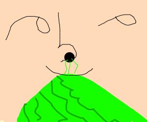 man smelling lettuce