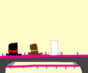 Pink conveyer belt carrying top hats in a cav