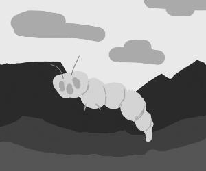 Creepy ghost caterpillar in rocky landscape