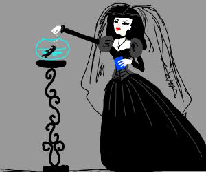 Goth lady feeding fish