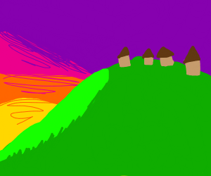 village on a hill at sunset