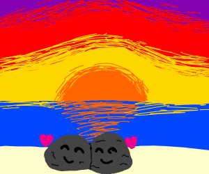 Rocks enjoying sunset on beach. In love
