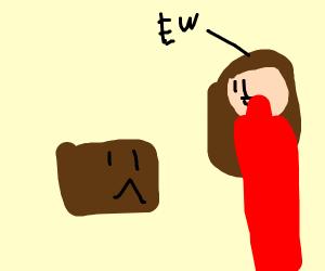 Girl ew at sad brown box