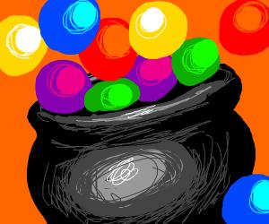 A black pot and a lot of colourful balls