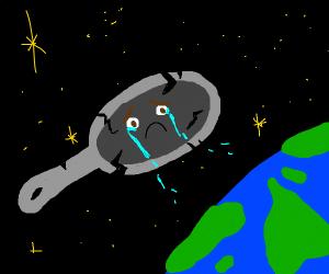 Sad broken pan in outer space