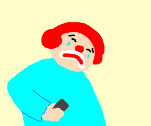 Sad clown with mobile phone