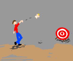 man throws baby