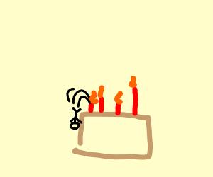 guy falling off birthday cake