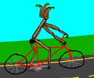 Stick figure riding bicycle