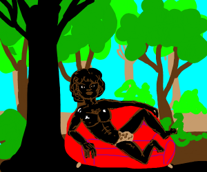black man on red couch in forest