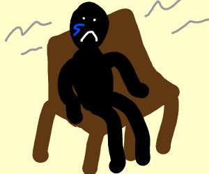 Sad person sitting on bench