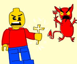 christian lego guy holds cross at the devil