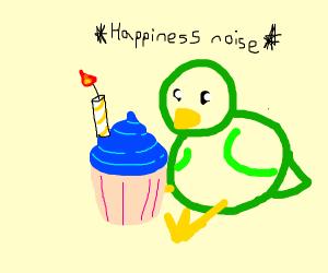 Green bird with a birthday cupcake.