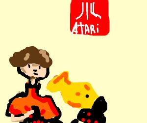 A Man and a Yellow Fish play some Atari