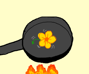 yellow flower flopping on a frying pan