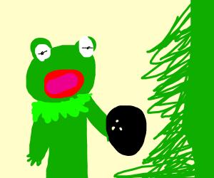 Kermit throws bowling ball at Christmas tree