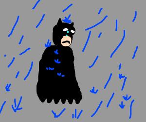 sad batman on a rainy day