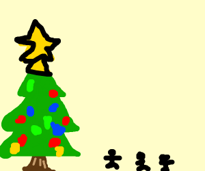 People looking at a christmas tree