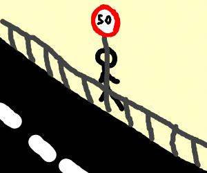 Man hiding behind a speed limit sign
