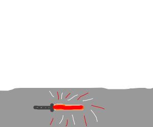red lightsaber on the floor