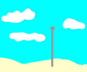 Empty Flagpole on a beach