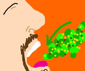 Man eats vomit