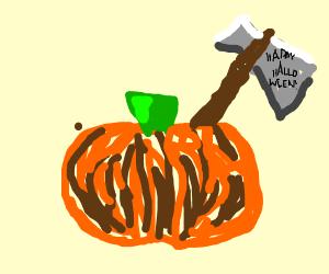Happy Halloween hatchet sticks out of pumpkin