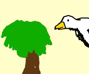 Bird flying beside the tree