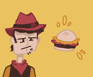 Cowboy looking at burger