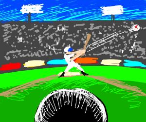 A person hitting a baseball