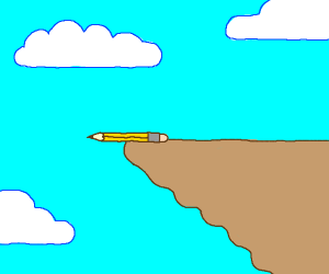 a pencil on the edge of a cliff