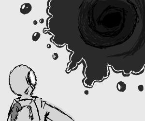 man looks at black hole