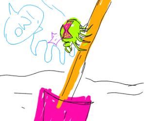 A spider climbing a shovel