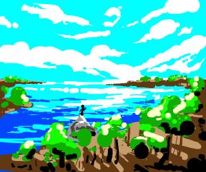 man eating next to the lake