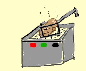 potato in a deep fryer
