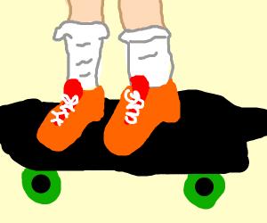 Skateboarder's legs