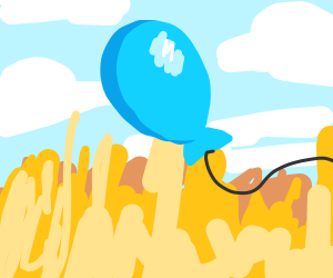 Blue baloon on a field
