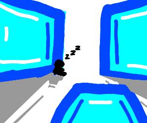 Man sleeps next to big ice cubes