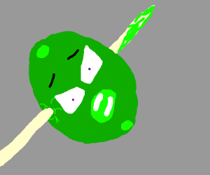 a green olive being impaled