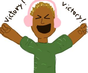 Guy with pink headphones celebrates victory