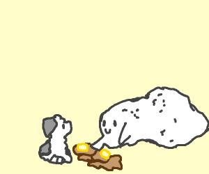 a glob of glue feeding a dog some pancakes