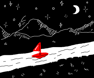 Red sailboat on river at night