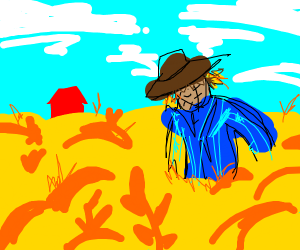 A smiling scarecrow in wheat field.