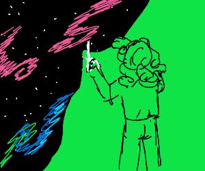 A man with a long hair cuts the galaxy