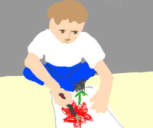 boy sitting crisis cross drawing a red flower
