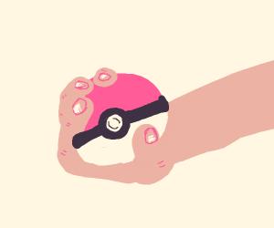 Hand holding Pokeball
