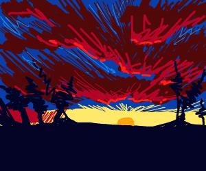 A sunset behind a thunderstorm