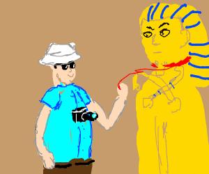 King tut on a tourist's leash