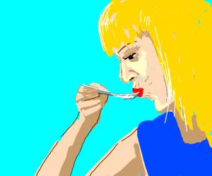 woman eats soup
